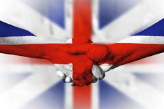 Hand covered in flag of United Kingdom Stock Photos