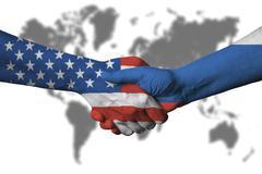 Usa and Russian flag across handshake. Stock Photos