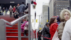 people tourist kids having fun TKTS red stairs busy crowded Times Square NYC 4K - stock footage