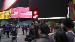 Panning shot of tourists, people in busy crowded Times Square in winter 4K NYC Stock Footage
