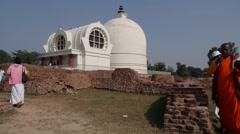 Buddhist pelgrims sing where Buddha died,Kushinagar,India Stock Footage