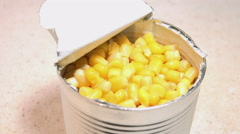 Close-up View of Man Eating the Corn Kernels from a Metal Jar. 4K Stock Footage