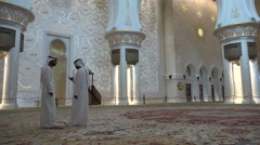 Two guides inside the Sheikh Zayed Grand Mosque in Abu Dhabi Stock Footage