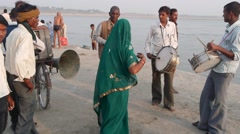 A lady dances at Sangam,Allahabad,India Stock Footage