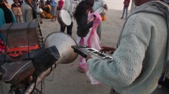 Musicians play music at Sangam,Allahabad,India Stock Footage