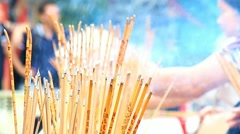 Detailed look at burning incense sticks in Buddhist monastery Stock Footage