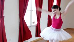 young attractive ballerina doing funny grimaces - interior - red curtain - stock footage