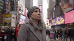 tourist, pretty girl lost in Times Square, in 4K, New York City NYC - stock footage