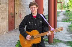Hooligan with guitar - stock photo