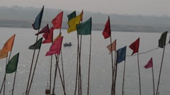 flags on ghat at the ganges,Varanasi,India - stock footage