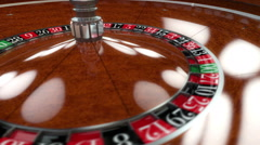 Casino Roulette wheel spin closeup Stock Footage
