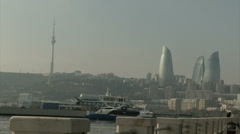 View of the towers of Baku (Azerbaijan) from the sea through the embankment. Stock Footage