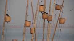 Poles and baskets at ghat,Varanasi,India - stock footage
