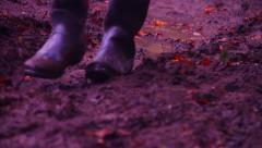 Wellies walk through mud Stock Footage