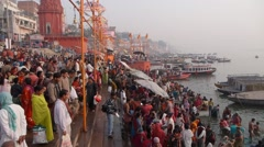 Crowds at main bathing ghat,Varanasi,India - stock footage