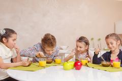 Kids have lunch at home Stock Photos