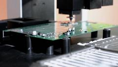 Installation of components on the printed circuit Board of a robot manipulator - stock footage