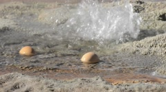 Two eggs boiling in geothermal waters of the El Tatio geyser, Chile. Stock Footage