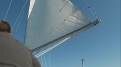 OTS of unidentifiable man sailing. Stock Footage