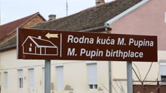 Michael I. Pupin birthplace, signpost in Idvor Stock Footage