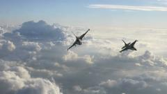 Two F-16 Fighter Jets Fly Below the Camera Stock Footage