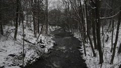 Scenic Babbling River with Light Snowfall Stock Footage