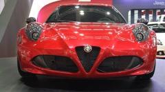Luxury sports red car Alfa Romeo 4C on Belgrade Car Show - stock footage