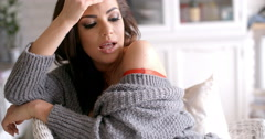Seductive Woman in Cardigan Touching her Hair Stock Footage