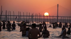 Crowds bathing at Sangam during Kumbh Mela,Allahabad,India Stock Footage