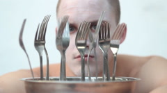 Freaky guy looking through the forks Stock Footage