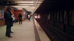 Subway train pulling into station, public transportation platform tunnel NYC 4K Stock Footage