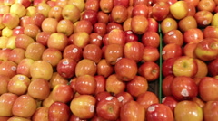 Organic Fruit Selection of apples and oranges at grocery store  - stock footage