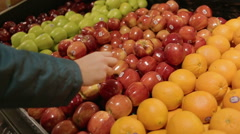 Women Selecting Organic Red Apples to Buy  Stock Footage