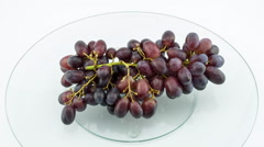 Grape disappears from glass table, stop motion Stock Footage