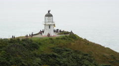 Tourists at the Lighthouse at Cape Reinga Stock Footage