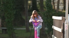 Girl Bounces On A Pogo Stick Toy Stock Footage