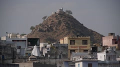 Small temple on hill with birds,Pushkar,Rajasthan,India Stock Footage