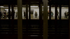 people waiting for train to arrive on MTA subway platform, other side 4K NYC - stock footage