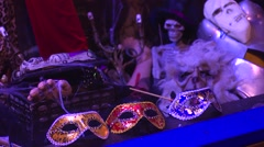 Stock Video Footage of Halloween Masks Adorn a Shop Window