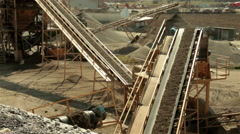 Separation of sand. Sand going on conveyor belt and falling on pile. High angle. Stock Footage