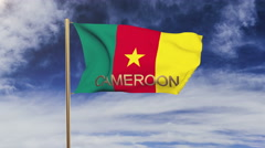 Cameroon flag with title waving in the wind. Looping sun rises style.  Animation Arkistovideo