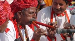 Rajastahni man with twin flute,Bundi,Rajasthan,India Stock Footage
