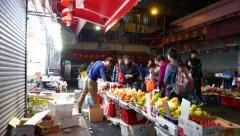 Fruits and vegetables stall on the night market Stock Footage