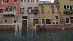 Water track past houses flooded due to sea level rise in Venice - stock footage