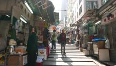 Walking up at narrow market street, nice lighting Stock Footage