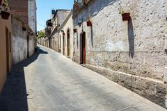 Narrow Alley and Stone Buildings - stock photo