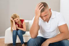 Portrait Of Young Stressed Couple At Home - stock photo