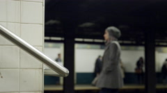 Woman waiting on station platform for subway train in 4K NYC Stock Footage