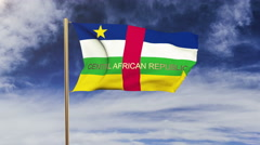 Central African Republic flag with title waving in the wind. Looping sun rises Stock Footage