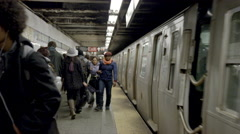Subway platform New Yorkers, commuters traveling public transportation 4K NYC Stock Footage
